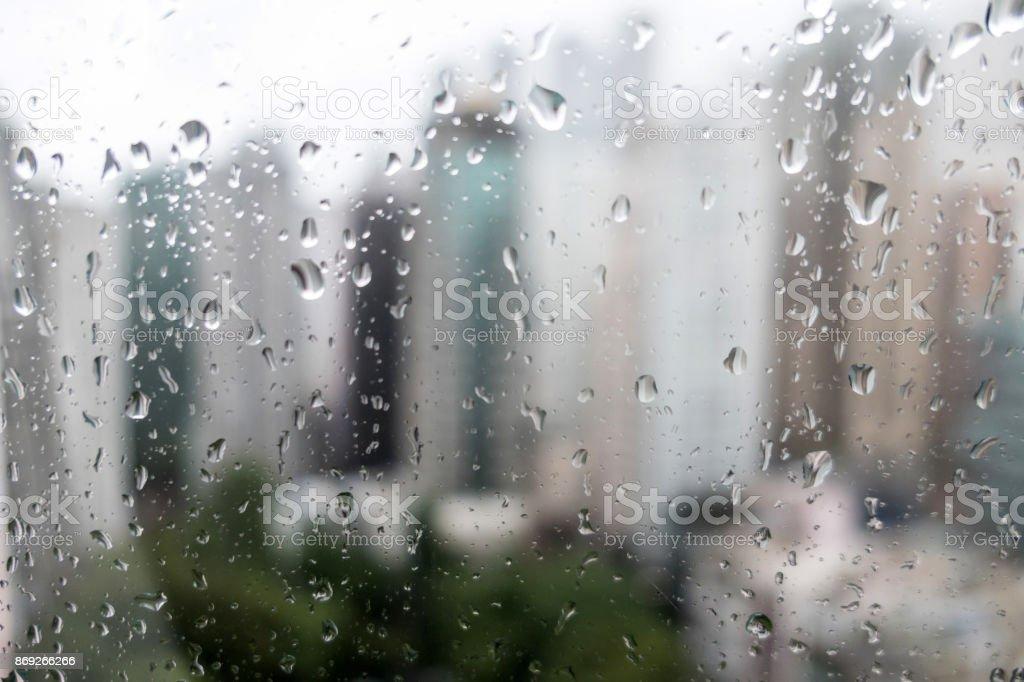 Hong Kong skyline through a rain soaked window stock photo