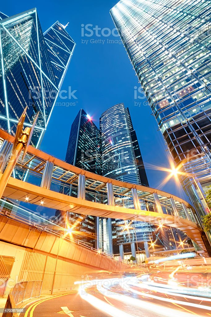 Hong Kong skyscrapers lit up against night sky stock photo