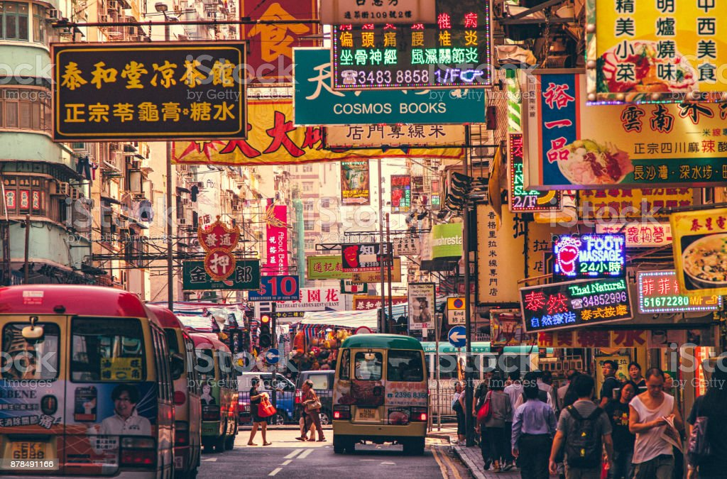 Hong Kong Street Scene, Mongkok District with busses stock photo
