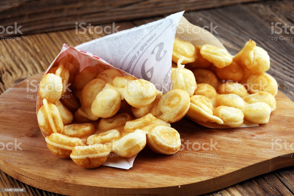 Hong Kong style egg waffle on wooden board. bubble waffle stock photo