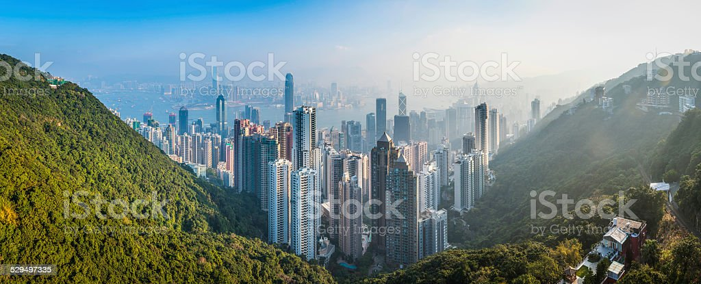 Hong Kong sunrise skyscrapers crowded cityscape and harbour panorama China stock photo