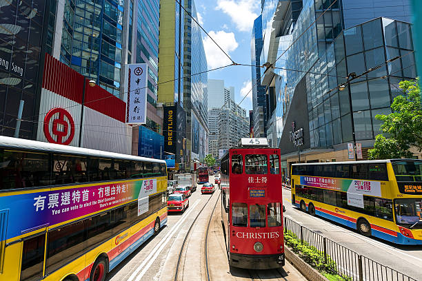 Hong Kong Tram Hong Kong, Hong Kong SAR - June 4 2015: Double-decker trams. Trams also a major tourist attraction and one of the most environmentally friendly ways of travelling in Hong Kong bank of china stock pictures, royalty-free photos & images