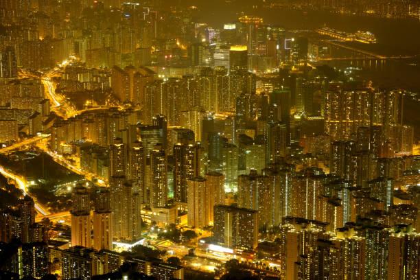 stadtgebiet von hong kong bei nacht-szene - kowloon stock-fotos und bilder