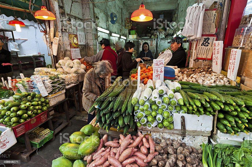 Hong Kong vegetable market stall customers stock photo