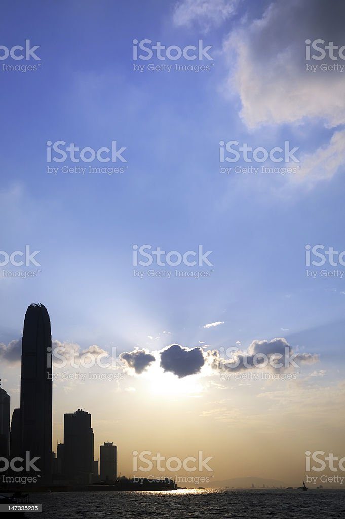 Hong Kong Victoria Harbor Sunset Scene with commercial building silhouette royalty-free stock photo
