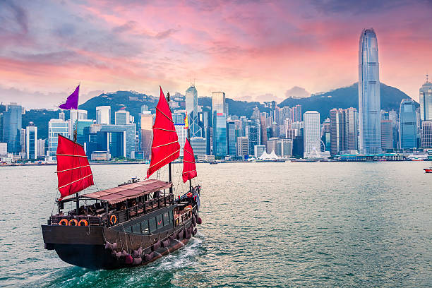 Hong Kong Victoria Harbour Sailboat travel to Hong Kong Victoria Harbour at sunset new territories stock pictures, royalty-free photos & images