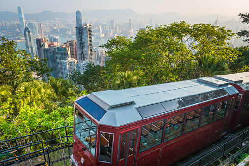 Hong Kong Victoria Peak Tram Climbing Above Harbour Skyscrapers China Stock Photo - Download Image Now