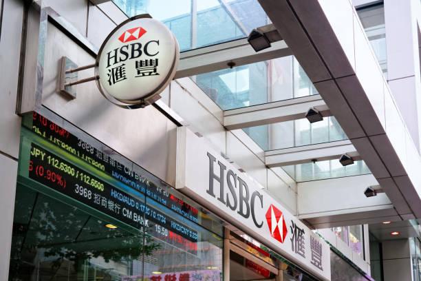 HSBC Hongkong and Shanghai Bank plate Hong Kong, Hong Kong - March 9, 2016: HSBC Hongkong and Shanghai Bank plate on the entrance into HSBC bank hsbc stock pictures, royalty-free photos & images