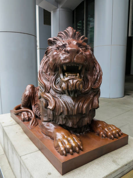 "HSBC Hongkong Lion Statue 8/28/2014, HSBC Hongkong Lion Statue: The picture shows one of two famous lions at the HSBC Headquarter in Hongkong. This one (the left) is nicknamed ""Stephen"" bank of china stock pictures, royalty-free photos & images"