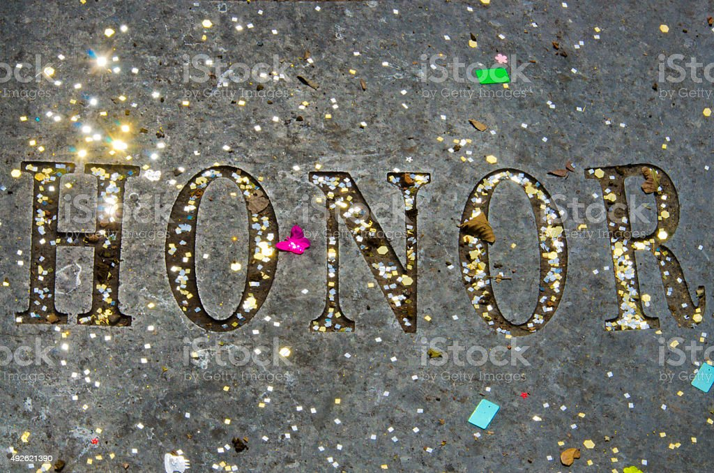 Honor Spelled Out with Sparkling Confetti stock photo