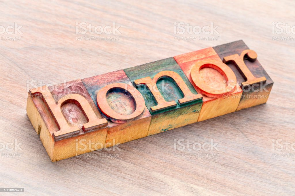 honor word abstract in wood type stock photo
