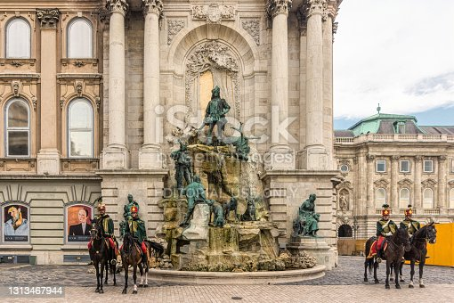 Budapest, Hungary - August 29 2019: Guardsmen of the Guard of Honor at the Royal Palace in Budapest on Buda Hill, Hungary. Soldiers on horseback in traditional dress uniform. An ancient ceremony