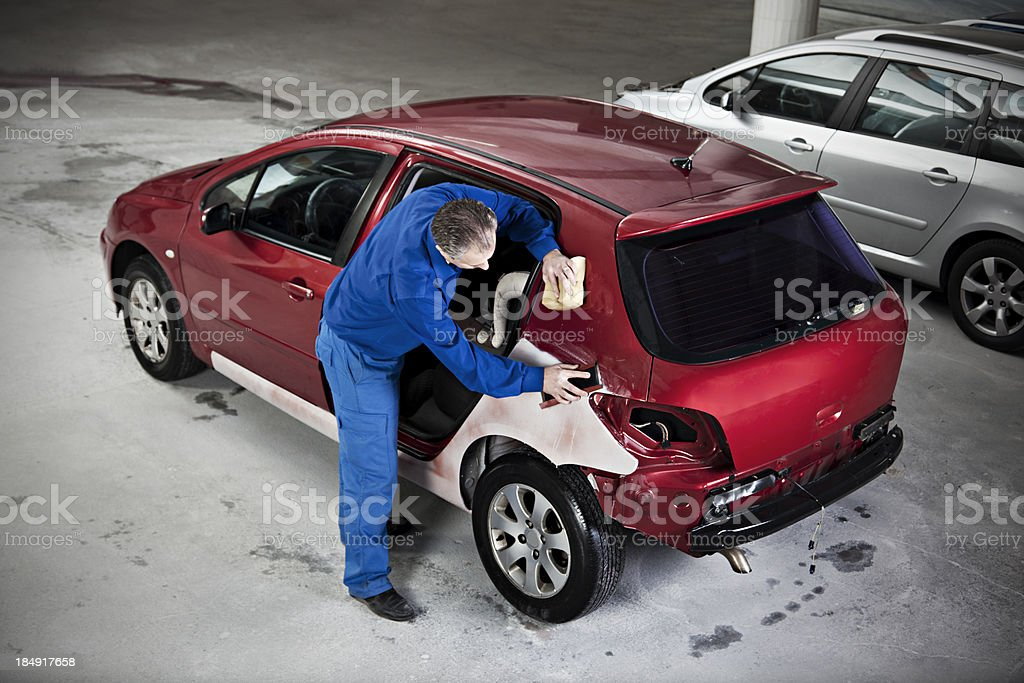 hood repair man stock photo