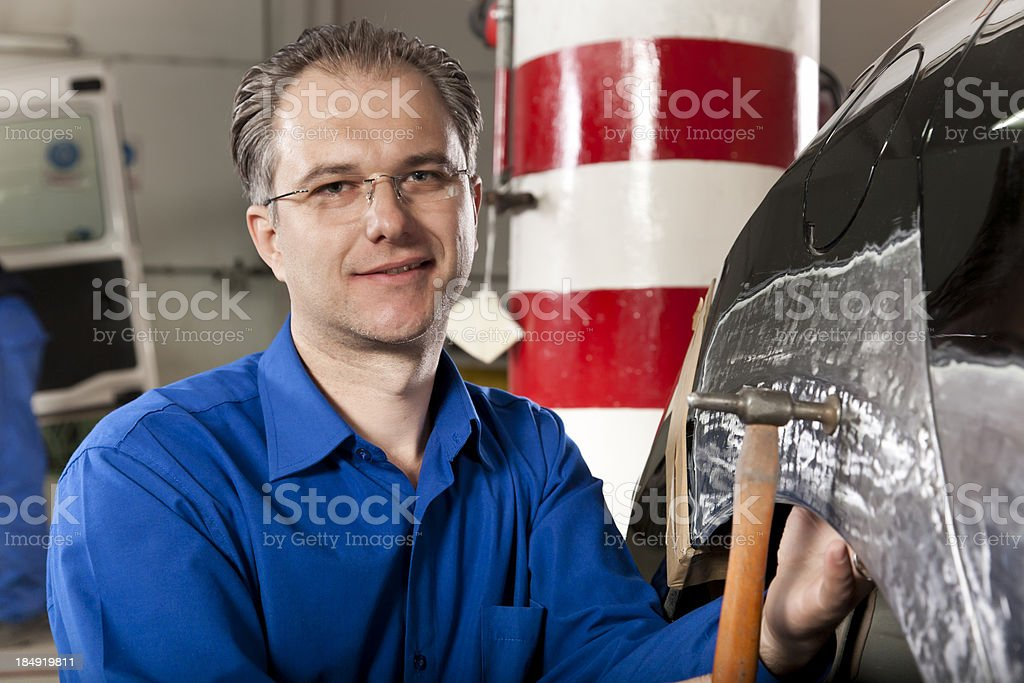 hood repair man smiling royalty-free stock photo