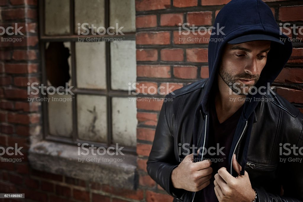 Hooded and handsome man in street scene Lizenzfreies stock-foto