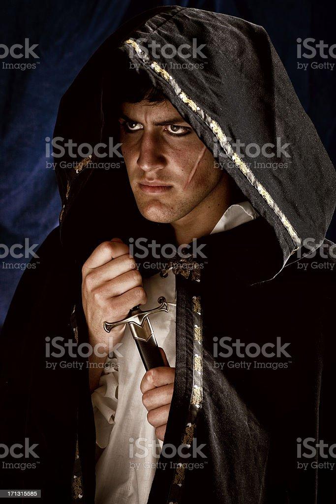 Hooded Assassin Brandishing Dagger stock photo