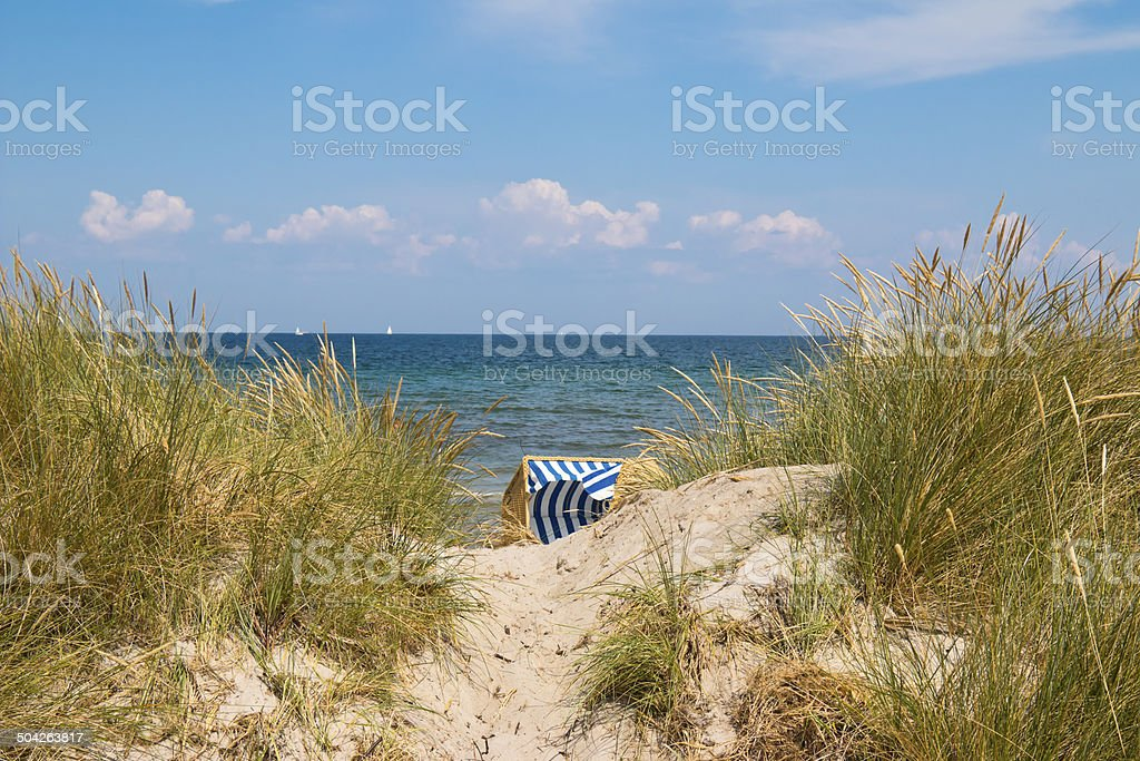 Hooded Beach Chair Between Dunes royalty-free stock photo