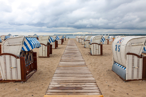 Hooded beach chairs (strandkorb) at Baltic seacoast in Travemunde, Germany
