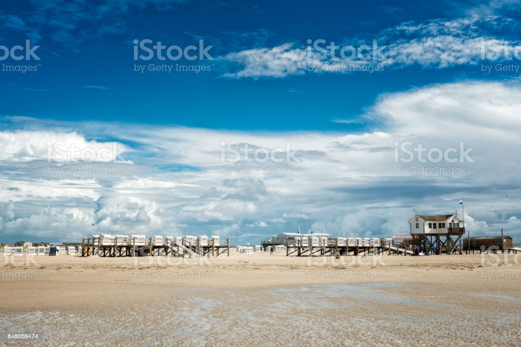 hooded beach chairs at St. Peter Ording at North Sea stock photo