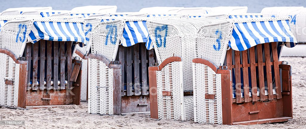 Hooded beach chairs in Germany stock photo