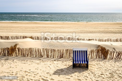 typical hooded beach chairs at a beach in north germany