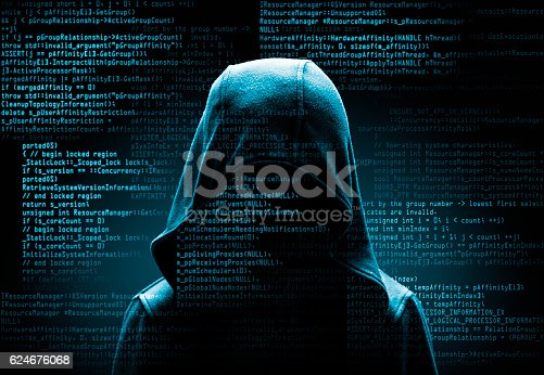 istock hooded computer hacker in the shadow with program codes 624676068
