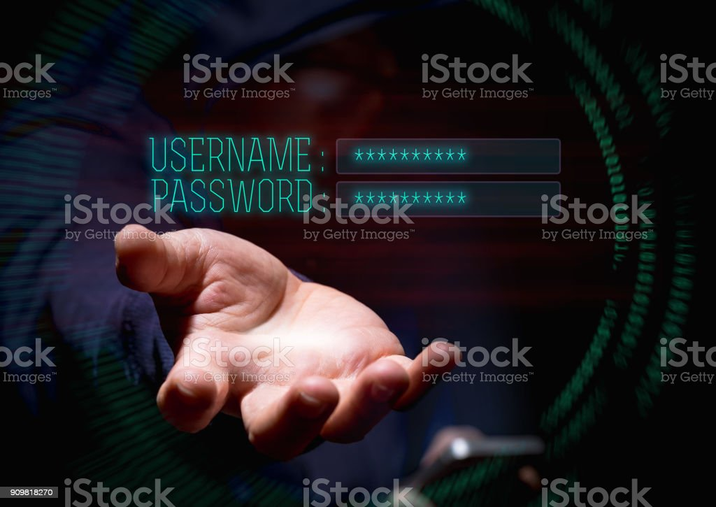 Hooded cyber crime hacker using mobile phone and internet hacking in to cyberspace for username and password,online personal data security concept stock photo