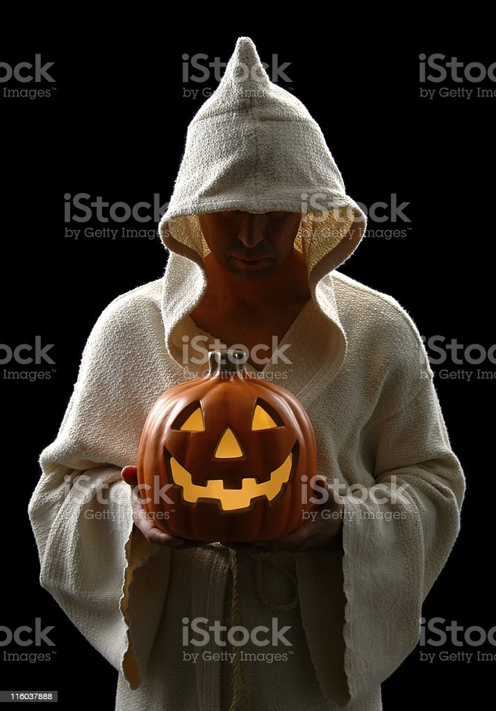 Hooded Man and Jack-0-Lantern royalty-free stock photo