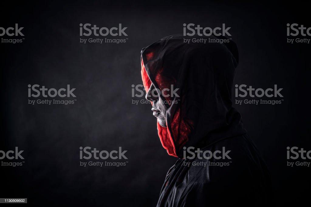 Hooded man in the dark Hooded man in the dark Adult Stock Photo