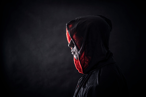 Hooded Man In The Dark Stock Photo - Download Image Now