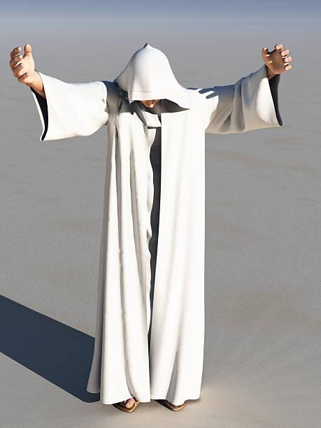 Hooded man preaching stock photo