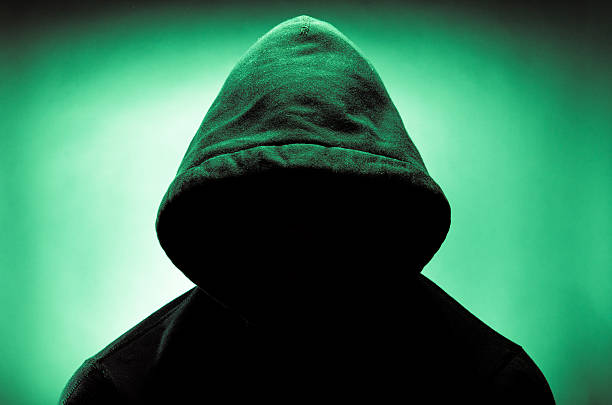 Hooded man with face in shadow image of a hooded man with his face in shadow creepy stalker stock pictures, royalty-free photos & images