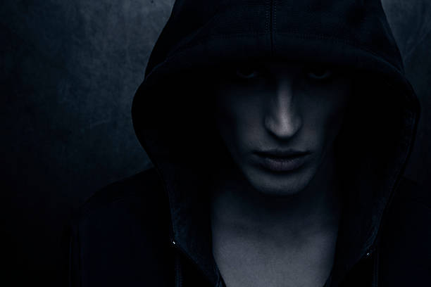 hooded person - demon stock photos and pictures