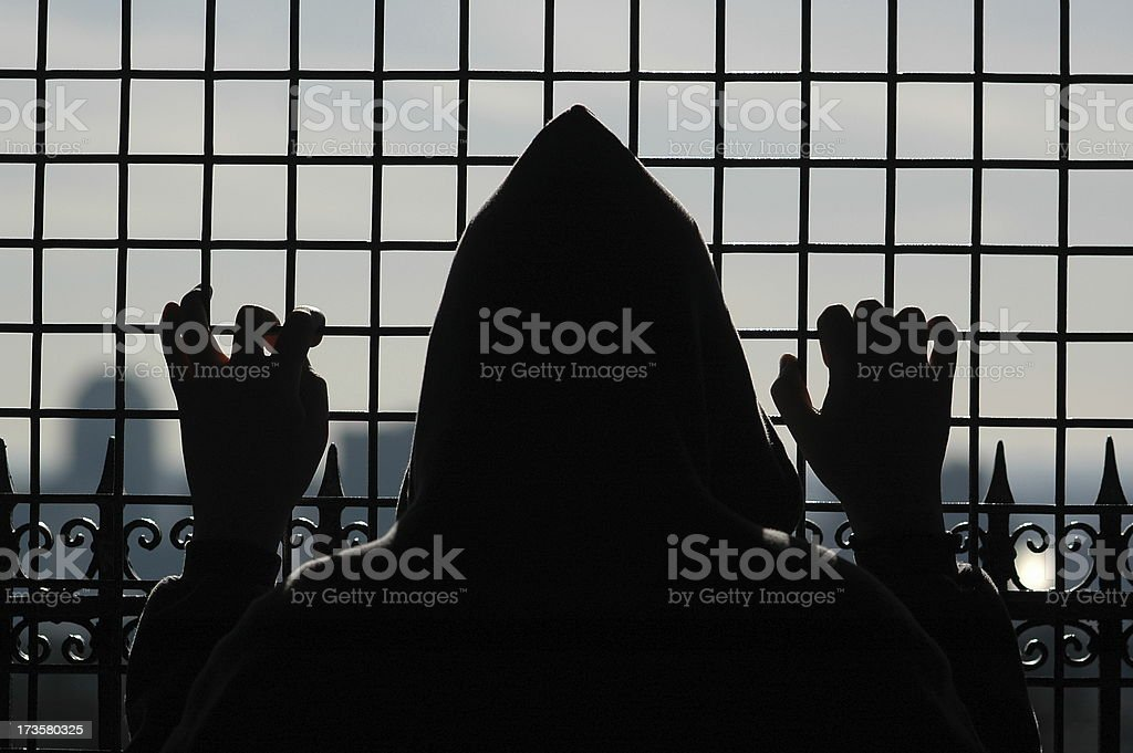 hooded visitor royalty-free stock photo