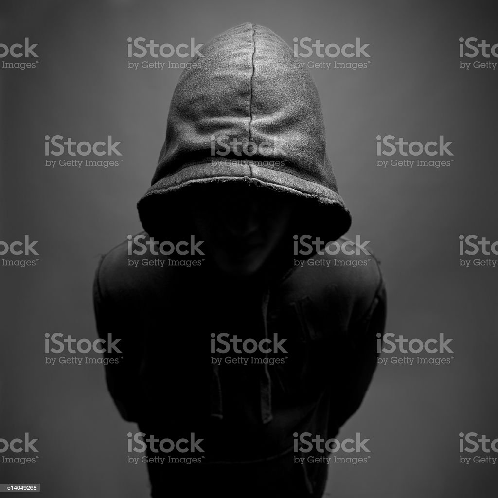 Hooded youth stock photo