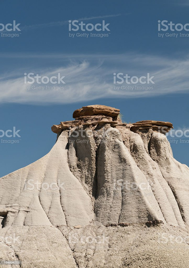 Hoodoo against a blue sky in Alberta, Canada stock photo