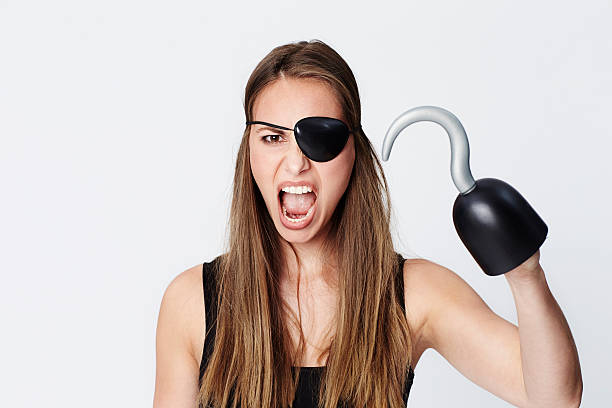 Hook for a hand pirate Hook for a hand pirate beauty in studio costume eye patch stock pictures, royalty-free photos & images