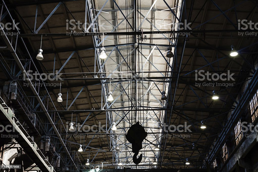Hook hanging under the roof of foundry factory stock photo