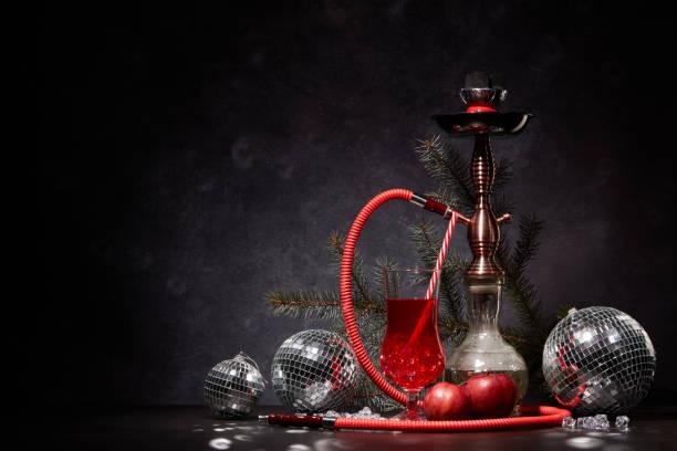 Hookah (Shisha) and cocktail. New Year and Christmas stock photo