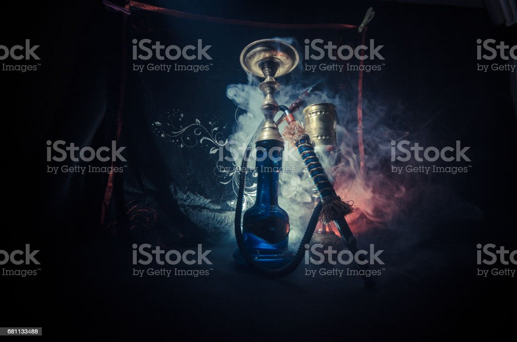 Hookah hot coals on shisha bowl with black background. Stylish oriental shisha stock photo