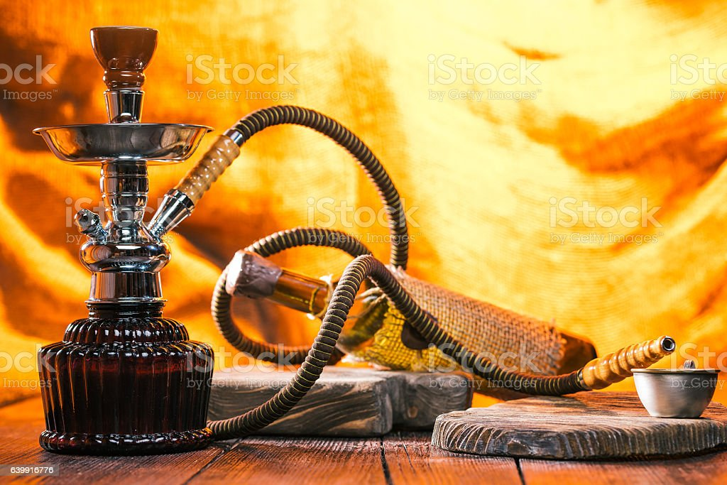 Hookah over fire light background stock photo