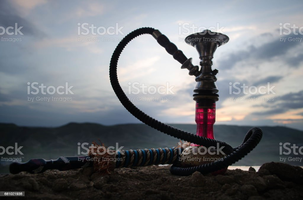 Hookah, traditional arabic waterpipe, direct sunset light, outdoor photo royalty-free stock photo