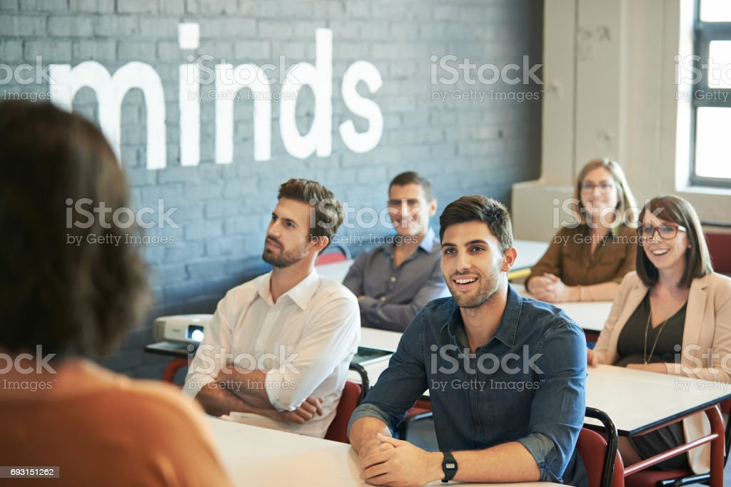 Hooked on her every word stock photo
