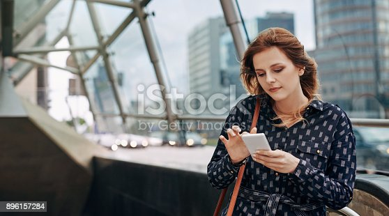 Shot of an attractive young woman using a mobile in the city