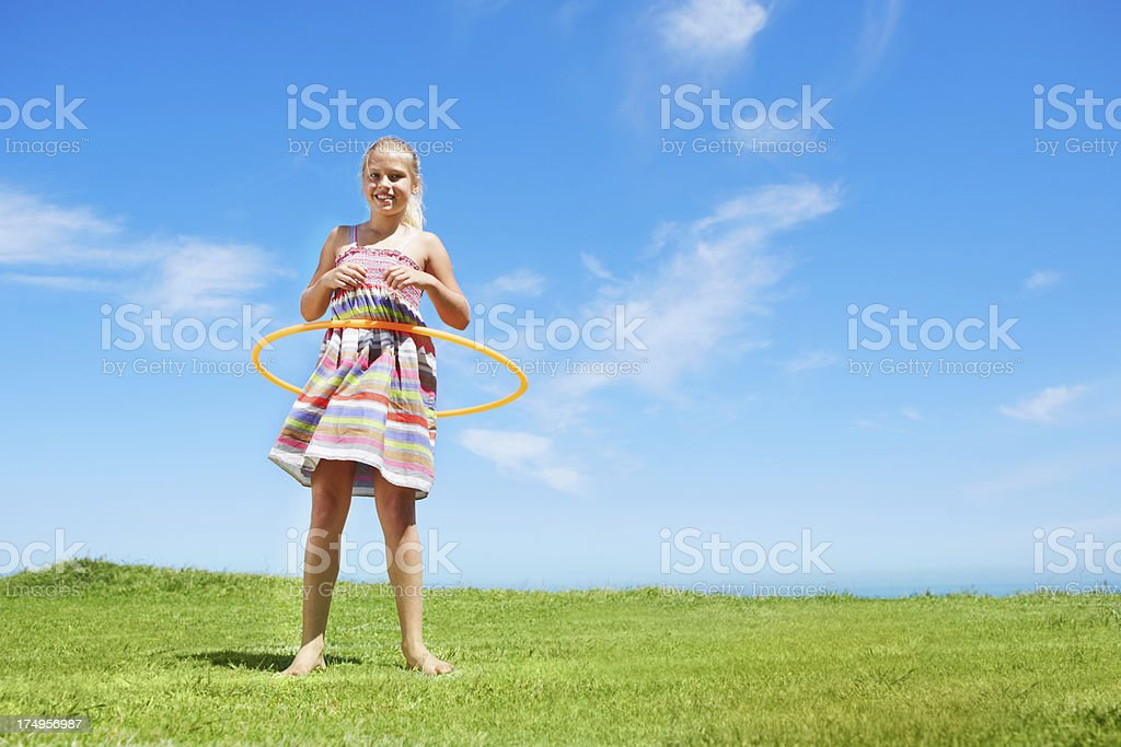 Hoolahooping and copyspace royalty-free stock photo