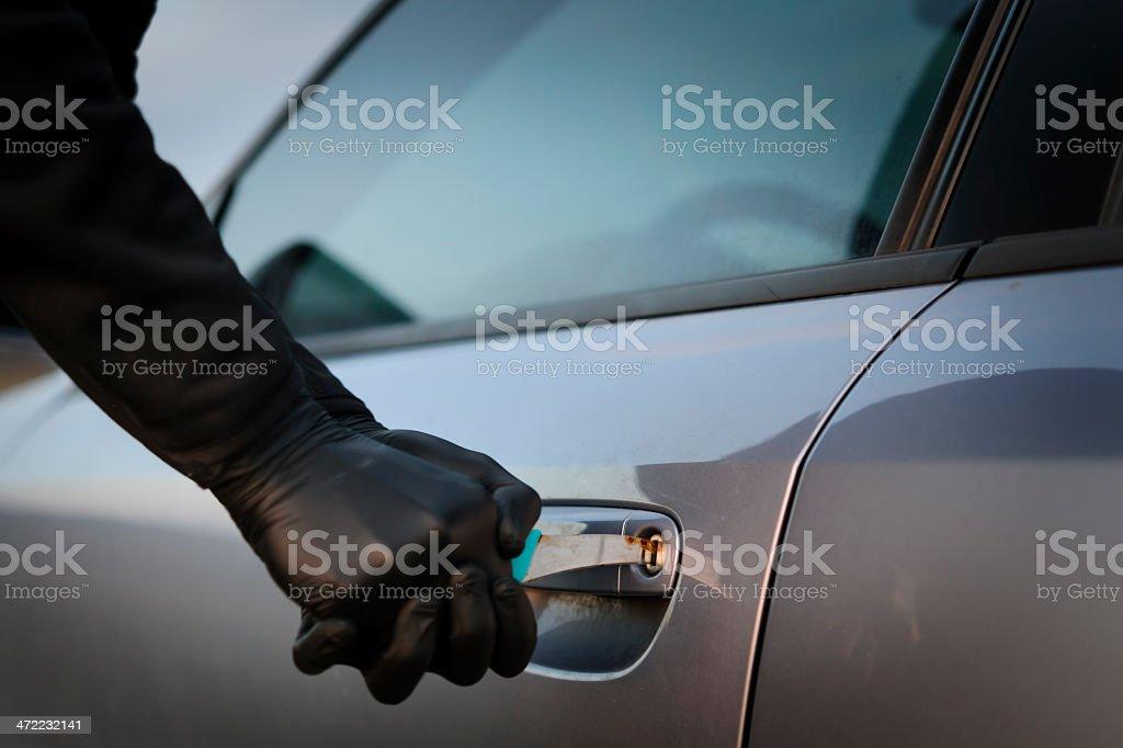 hooligan trying to breake car stock photo
