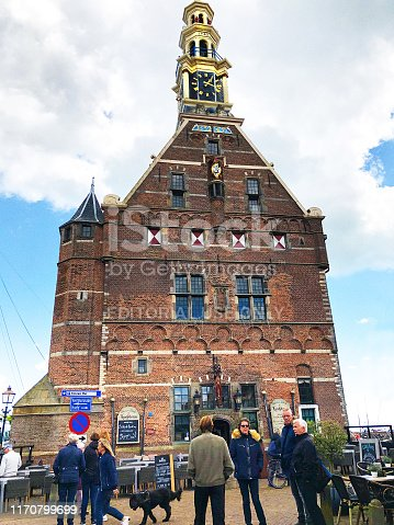 Hoorn, Holland: Tourists at the 15th century Hoofdtoren (harbor control building) in historic Hoorn, province of North Holland.