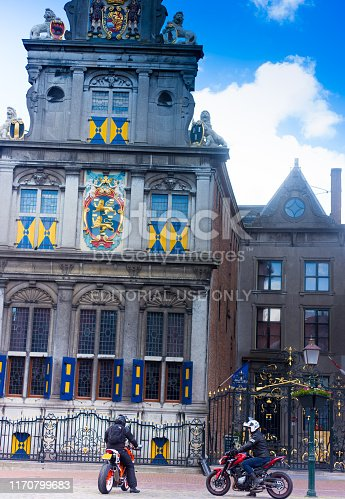 Hoorn, North Holland, Netherlands: Bikers in front of the ornate Westfries Museum in historic downtown Hoorn; the building was formerly Hoorn's Town Hall, dating from 1632.