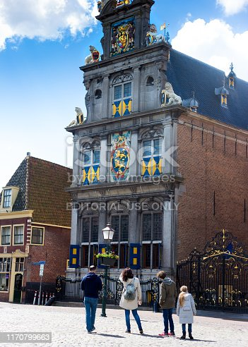 Hoorn, North Holland, Netherlands: Tourists admiring the ornate Westfries Museum in historic downtown Hoorn; the building was formerly Hoorn's Town Hall, dating from 1632.