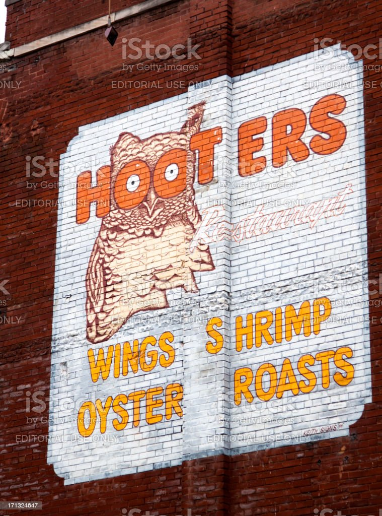Hooters Sign Painted on a Brick Building stock photo